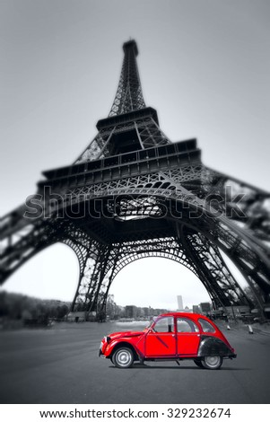 summer sunset vintage red car stands on the Champ de Mars. Eiffel Tower - stock photo