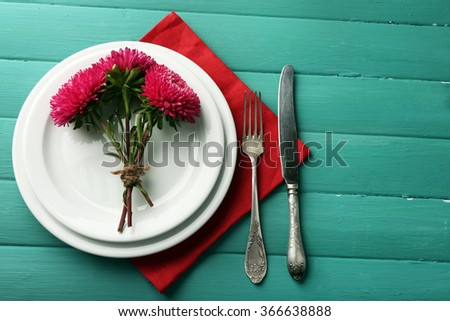 Summer table setting  on color wooden background - stock photo
