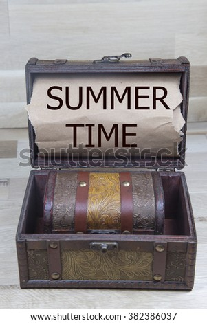 summer time is written on the Brown torn paper in the treasure box