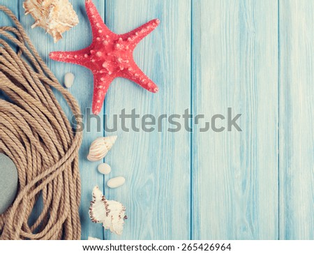 Summer time sea vacation background with star fish and marine rope. Retro toned - stock photo