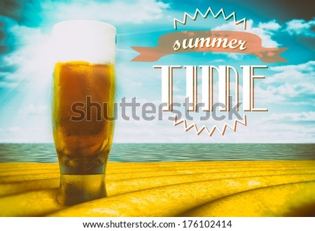 Summer time sign with beer glass on beach - stock photo