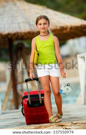 Summer travel, beach - lovely girl ready for summer vacation - stock photo
