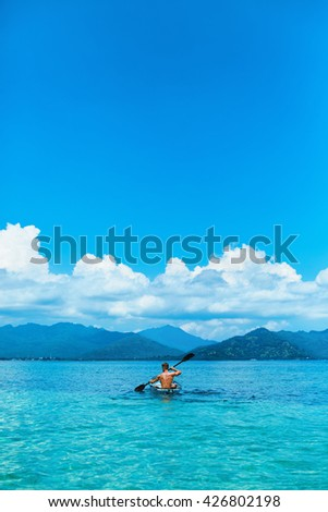 Summer Travel Kayaking. Man Paddling Transparent Canoe Kayak In Tropical Ocean, Enjoying Recreational Sporting Activity. Male Canoeing With Paddle, Exploring Sea On Vacation. Rowing Water Sports - stock photo