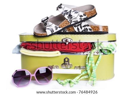 Summer travel suitcase - stock photo