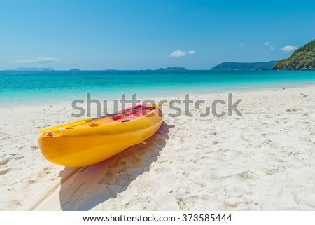 Summer, Travel, Vacation and Holiday concept - Orange kayaks on the tropical beach, Thailand - stock photo