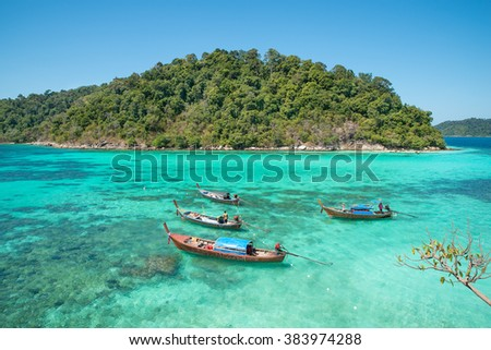 Summer, Travel, Vacation and Holiday concept - Tropical beach, longtail boats at Lipe island in Satun, Thailand - stock photo
