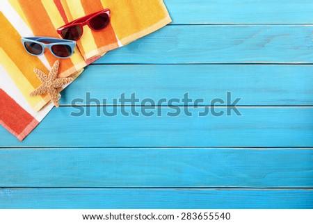 Summer tropical beach background, sunglasses, starfish, copy space - stock photo
