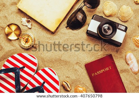 Summer vacation accessories on tropical sandy ocean beach, holidays abroad - summertime lifestyle objects in flat lay top view arrangement - stock photo