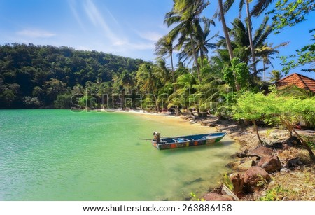 Summer vacation:  beach with wooden boat and blue sky at Koh Ngam, Thailand - stock photo