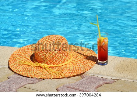 Summer vacation concept photo near swimming pool with beach items
