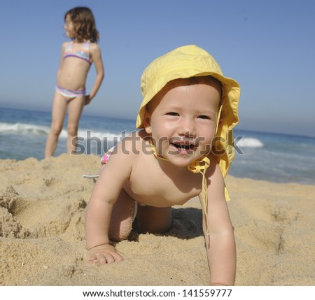Summer vacation: Happy baby on the beach