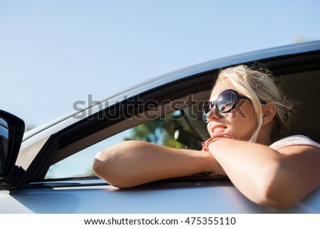summer vacation, holidays, travel, road trip and people concept - happy smiling teenage girl or young woman in car