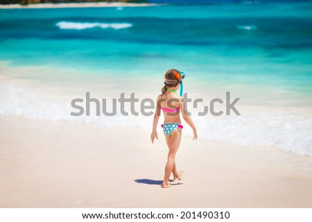 Summer vacation - Kid girl in face masks and snorkels, sea in background. - stock photo