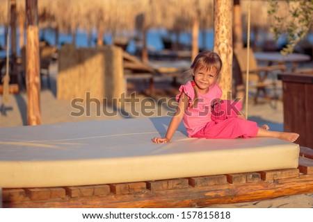 Summer vacation - lovely girl on the beach - stock photo