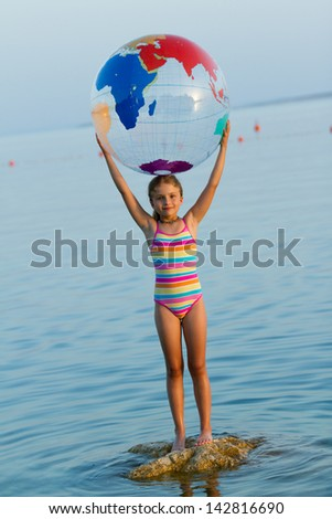 Summer vacation -  lovely girl playing in the sea (summer travel concept) - stock photo