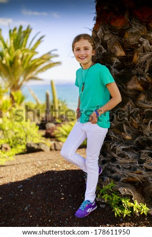 Summer vacation - Portrait of lovely, young girl in beach resort - stock photo