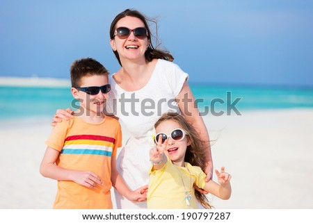 Summer vacation portrait of mother and two kids