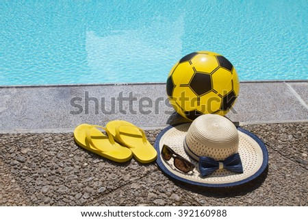 Summer vacation. Sandals and accessory by swimming pool. Blue sea surface with waves, texture water. Flat mock up for design. - stock photo