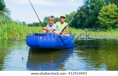 Summer vacation - Sister and brother fishing at the river
