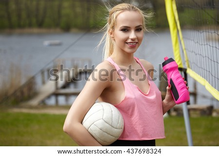 summer vacation, sport and people concept - young woman with volleyball ball - stock photo