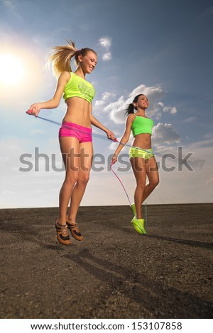 Summer vacation - women with skipping rope  - stock photo