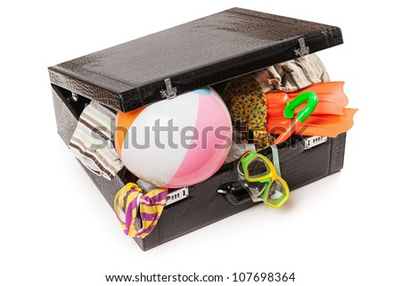 Summer vacations - open overfilled suitcase bag for travel luggage white isolated - stock photo
