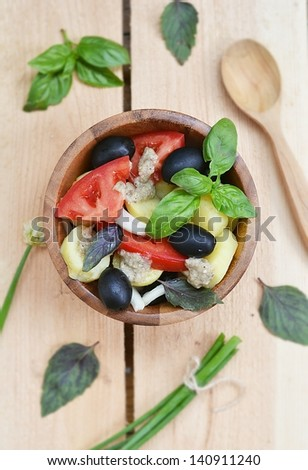 summer  vegetables salad in to the dish - stock photo