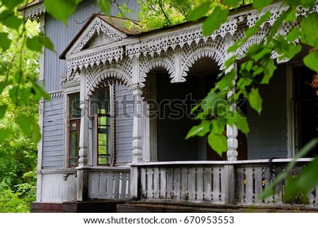 Summer Veranda With Vertical Columns Of Abandoned Old Wooden Carved House  Standing In The Middle Of