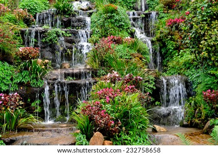 Summer view of beautiful small waterfalls - stock photo