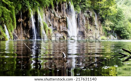 Summer view of beautiful small waterfalls in Plitvice Lakes National Park, Croatia - stock photo