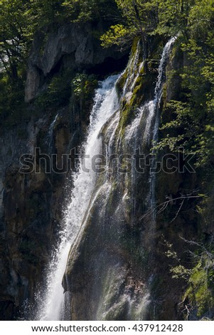 Summer view of beautiful waterfalls and footpath in Plitvice Lakes National Park, Croatia