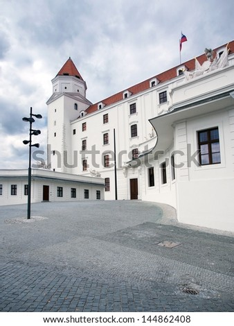 Summer view of courtyard of Bratislava Castle, Slovakia. Bratislava Castle is shown here in new white paint that was done during ongoing renovation and archeological preservation which begin in 2008. - stock photo