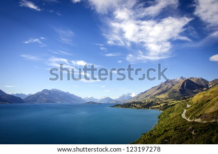 Summer view of New Zealand's lake Wakatipu and the road to Glenorchy - stock photo