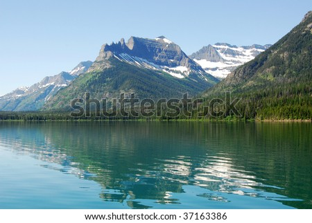 Summer view of the upper waterton lake and mountain from a cruising boat, waterton lakes national park, alberta, canada