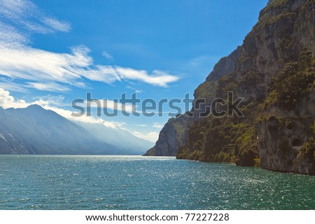 Summer View Over Lake Garda in Italy.?Good wind for windsurfing. - stock photo