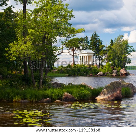 Summer water landscape with   summerhouse at the bank - stock photo