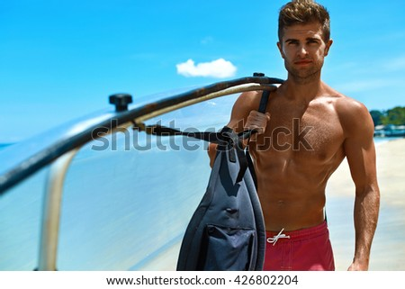 Summer Water Sport. Handsome Athletic Man With Sexy Body Holding Transparent Canoe Kayak. Beautiful Male Model Having Fun At Tropical Sea Beach. Travel Kayaking, Recreational Leisure Sporting Activity - stock photo