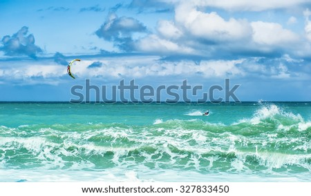 Summer watersport background of kite surfing and blue ocean water with waves and splashes  - stock photo