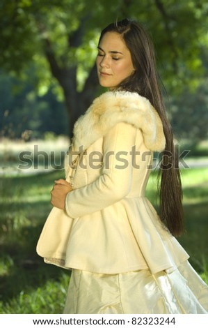 Summer wedding with young bride in park - stock photo