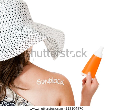 Summer woman wearing sunblock to protect her sking - isolated over white - stock photo