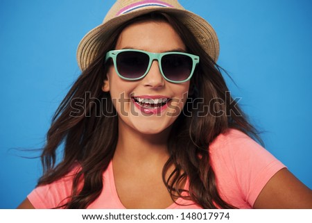 Summer woman wearing sunglasses and straw hat  - stock photo