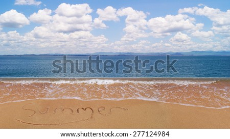 summer word on sand beach and wave of water at sea with blue sky and white cloud