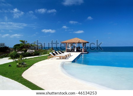 Private beach stock images royalty free images vectors for Cheap swimming pools near me
