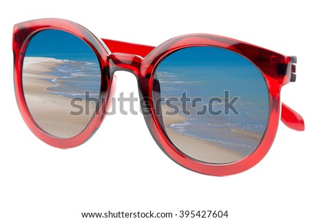 Summertime concept -  Sunglasses have a beach with blue sea  reflecting on isolated white background
