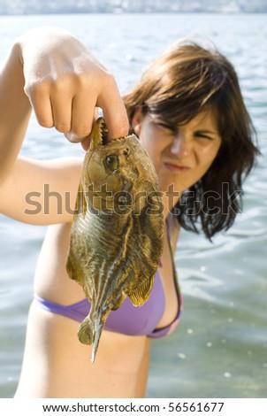Summertime - Girl bitten by piranha - stock photo