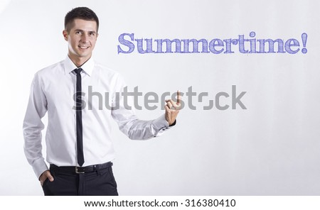 Summertime! - Young smiling businessman pointing on text