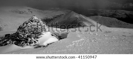 Summit cairn at the top of Swirral Edge in winter in the English Lake District - stock photo
