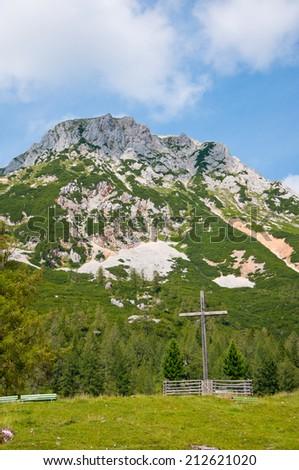 summit cross in the austrian mountains - Bachlalm in Filzmoos Salzburg - stock photo