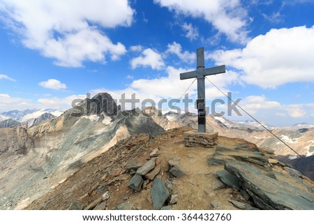 Summit cross on mountain Saulkopf and glacier panorama in Hohe Tauern Alps, Austria - stock photo