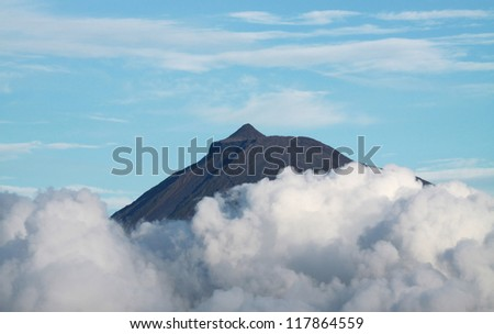 Summit of Volcano Mount Pico over clouds at Pico island (Azores)